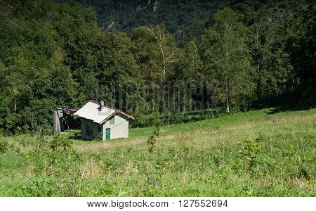 a solitary white house photographed at Piani d'Erna (part of the Alps) near Lake Como in Italy