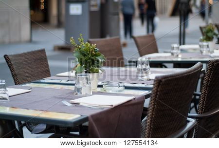 Lecco Italy - September 8th 2015: tables ready to welcome visitors at a restaurant in Lecco an Italian town near Lake Como.