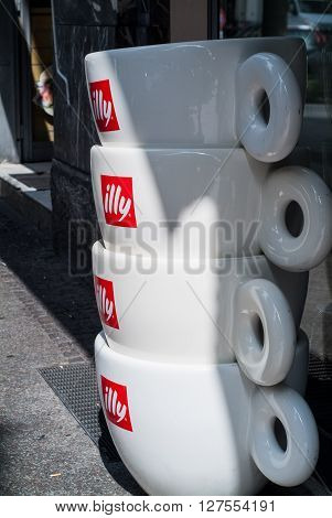Bergamo, Italy - September 9th 2015: a pile of giant illy cups photographed outside an illy coffee shop in Bergamo Italy.