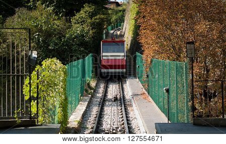 Bergamo Italy - September 9th 2015: a small passenger tram carrying people to the lower part of Bergamo a town near Lake Como.