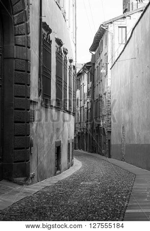 black and white photo of Via Arena in Bergamo a town near lake Como