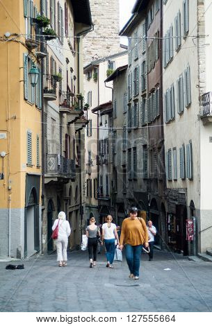 Bergamo Italy - September 9th 2015: people walking up and down a small street near Piazza Vecchia in Bergamo Alta North Italy.
