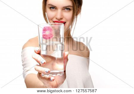 Beauty girl with glass of water red lipstick, Focus on glass