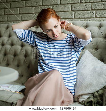 woman smarten oneself up at homehands in hairlooking down