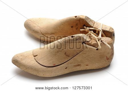 Pair of vintage wooden shoe lasts at white