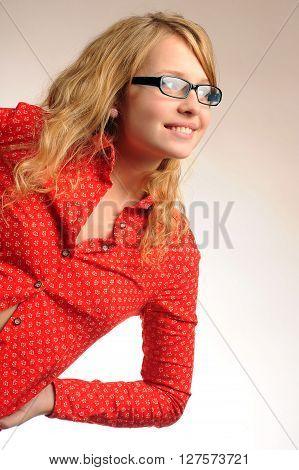 Pretty blonde girl in glasses leaned and looking sideways