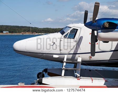 nose and propeller of seaplane in landing-place