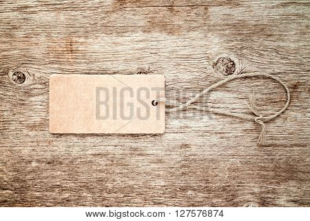 Blank tag tied with string. Price tag gift tag sale tag or address label.