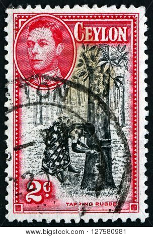 SRI LANKA - CIRCA 1938: a stamp printed in Sri Lanka shows Tapping Rubber Tree circa 1938