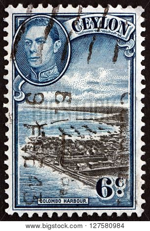 SRI LANKA - CIRCA 1938: a stamp printed in Sri Lanka shows View of Colombo Harbour and Portrait of King George VI circa 1938