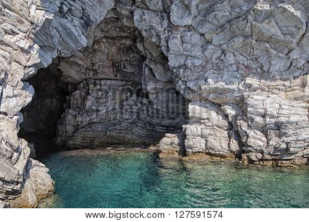Cave in a sea cliff near Marmaris, Turkey