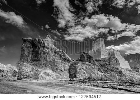 Ruins and Basgo Monastery surrounded with stones and rocks sky with clouds in the background Himalayan Mountain range Leh Ladakh Jammu and Kashmir India - black and white stock image of Indian monasteries