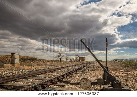 Deserted Railway track in the plains of Andalusia, Spain under a cloudy sky