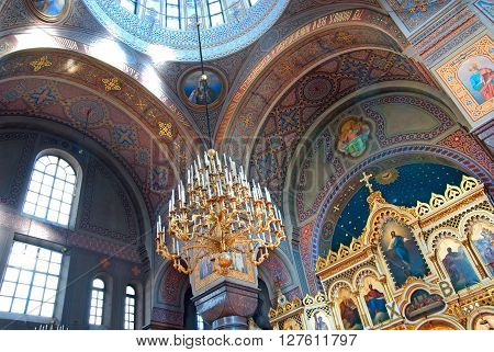 HELSINKI, FINLAND - APRIL 23, 2016: Interior of The Uspenski Cathedral with fragments of the blue cupola and iconostasis. It is the largest Orthodox cathedral in Northern and Western Europe.