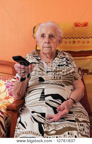 Senior Woman And Remote Control