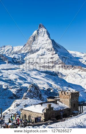 Zermatt Switzerland - December 31 2014 -Tourists at the Gornergrat train station with clear view to Matterhorn. It is a starting point of the ski slope.