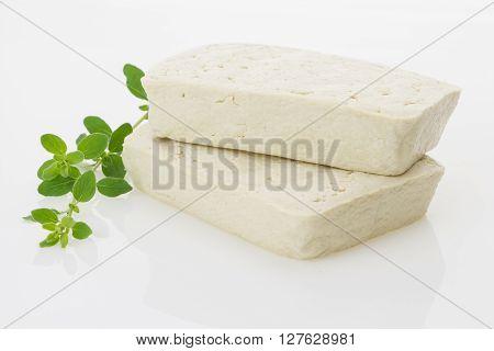 Tofu Blocks With Fresh Oregano, Isolated On White Background.