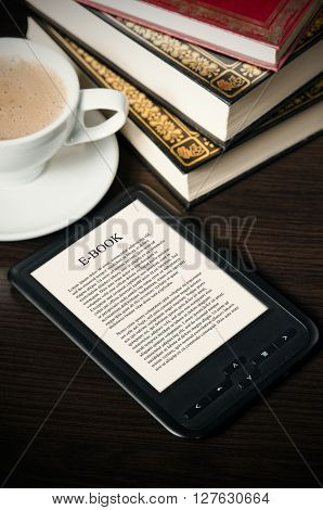 E-book Reader Device On Desk In Library