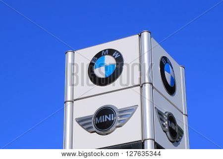 MELBOURNE AUSTRALIA - APRIL 24, 2016: BMW Mini Cooper car manufacturer.  German for Bavarian Motor Works, known as BMW is a German luxury vehicles and motorcycle manufacturing company founded in 1916