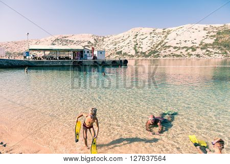 Rab Croatia - August 9 2015: Snorkeling in the clear waters of the island of Rab Croatia.