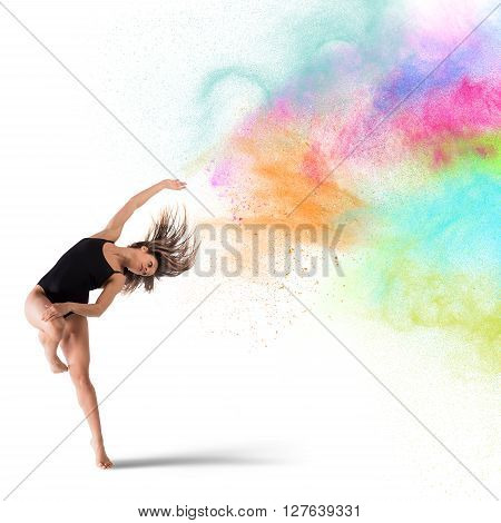 Agile woman dancer dance with colored pigments