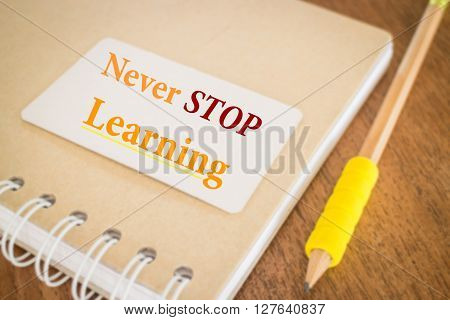 Never stop learning. Motivational quote about education stock photo