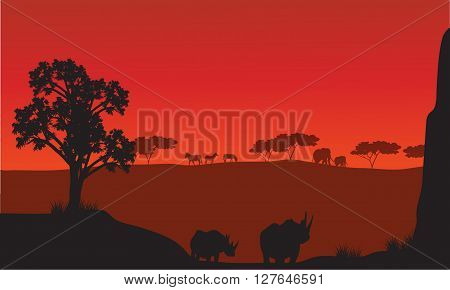 Silhouettes of african with rhino animals and red backgrounds