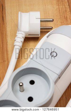 Electrical power strip with switch on-off on wooden floor electrical extension power board