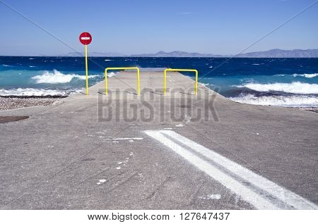 Pier and car parking lot by the sea in Rhodos Greece