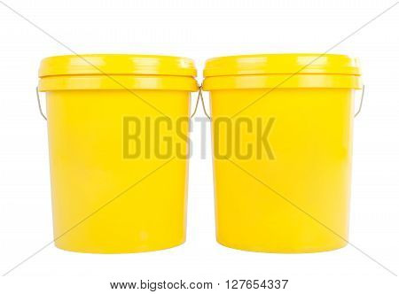 Yellow plastic bucket with yelllow lid. Product Packaging for lubricant oil.Isolated over white background.