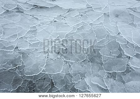 Many overlapping washed up and transparent ice floes