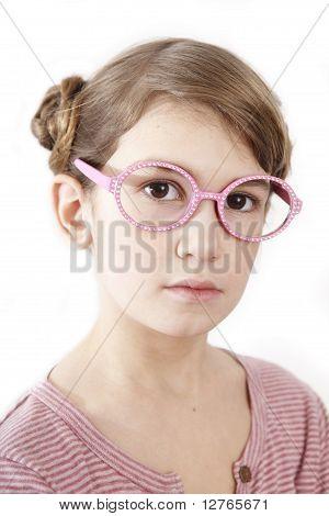 Serious Little Girl In Pink T-shirt