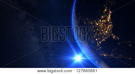 Planet Earth with a spectacular sunset, view on USA and Canada, with milkyway in background.