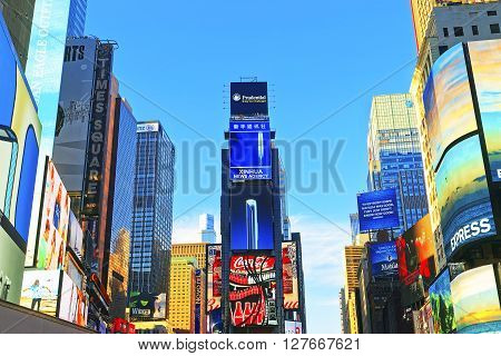 New York USA - April 26 2015: 7th Avenue and Broadway skyscrapers in Midtown Manhattan in New York USA. It is called Times Square. It is a commercial junction of Broadway and 7th Avenue.
