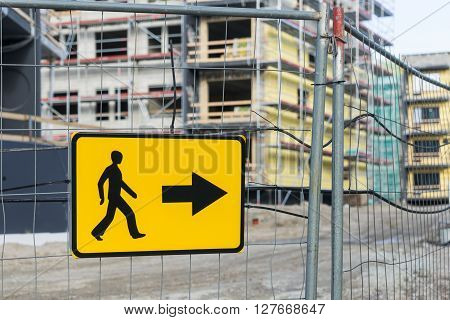 Detour road sign for pedestrian sidewalk near construction site