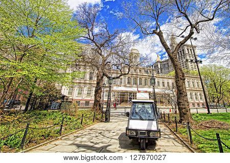 New York USA - April 24 2015: Car and City Hall in City Hall Park in Lower Manhattan New York USA.