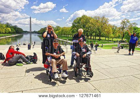 War Veterans At Lincoln Memorial Reflecting Pool Washington Dc