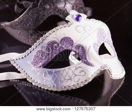 Venetian masks over black background horizontal image