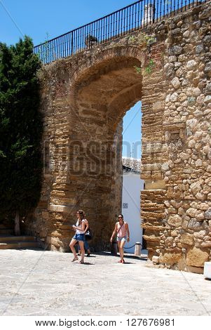ANTEQUERA, SPAIN - JULY 1, 2008 - Women walking through the Giants arch (Arco de los Gigantes) Antequera Malaga Province Andalucia Spain Western Europe, July 1, 2008.