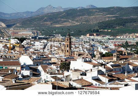 ANTEQUERA, SPAIN - JULY 1, 2008 - View over the town rooftops with San Sebastian church tower in the centre Antequera Malaga Province Andalucia Spain Western Europe, July 1, 2008.