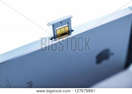 PARIS FRANCE - APR 21 2016: Instalation of the new SIM card in the new Apple iPhone SE combining the updated processor 4K rear camera touch id retina display