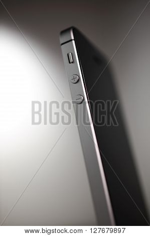 PARIS FRANCE - APR 21 2016: Side view of the new Apple iPhone SEvolume buttons - the new phone n combines the updated processor 4K rear camera touch id retina display