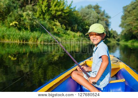 Summer vacation - Little boy fishing at the river