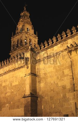 Wall and tower of the Mosque in Cordoba (Spain) at dusk.