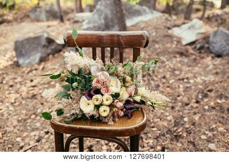 Bridal Bouquet. The Bride's Bouquet. Beautiful Bouquet Of White, Purple, Pink Flowers And Greenery,