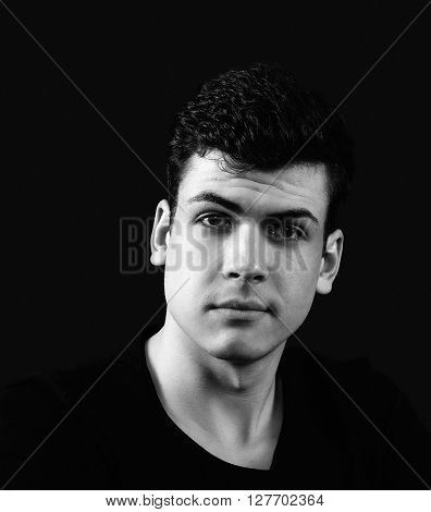 charismatic young man portrait in black and white