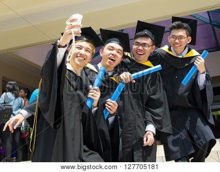 Setapak Kuala Lumpur Malaysia. Nov 07 2015:Graduates from Universiti Tunku Abdul Rahman (UTAR) share their joy with friends during convocation.UTAR is a leading public university in Malaysia.