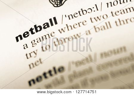 Close Up Of Old English Dictionary Page With Word Netball.
