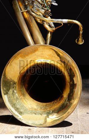 Detail view of brass wind instrument - golden tuba