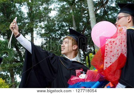 Setapak Kuala Lumpur Malaysia. Nov 07 2015:Graduates from Universiti Tunku Abdul Rahman (UTAR) share their joy with friendstaking selfie during convocation.UTAR is a leading public university in Malaysia.